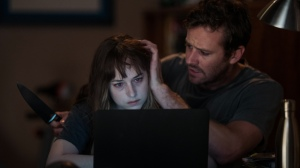 Armie Hammer and Dakota Johnson in 'Wounds'
